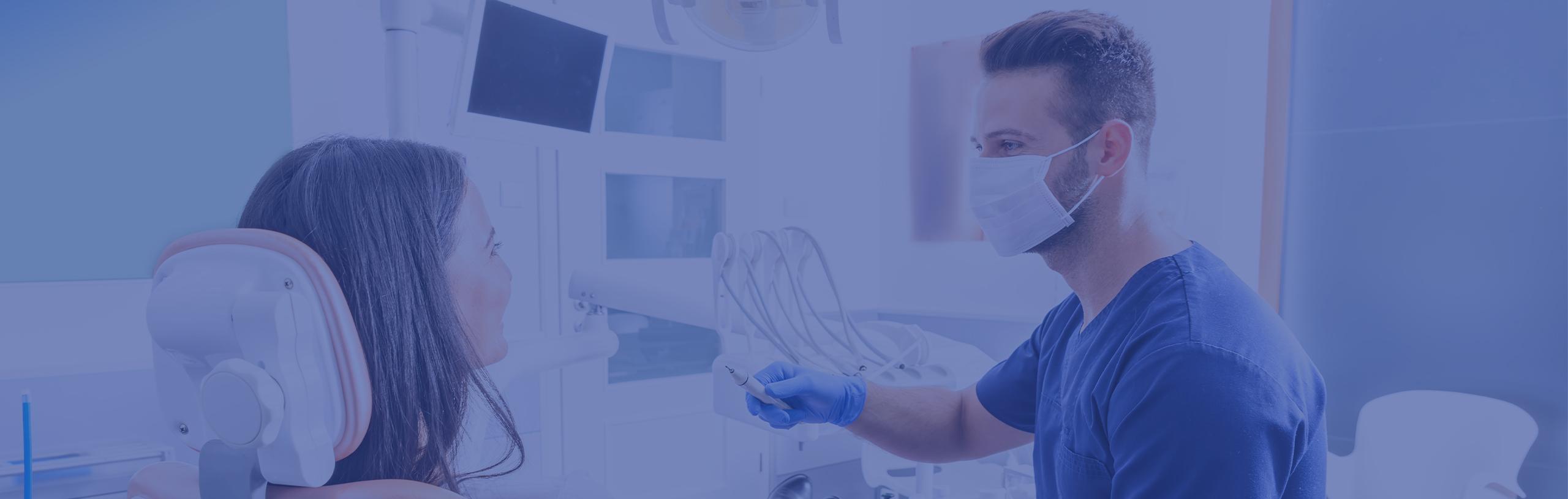 dentist speaking to a patient header